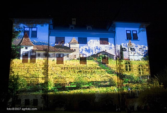 South Tyrol montage projected on to the 100 year old building